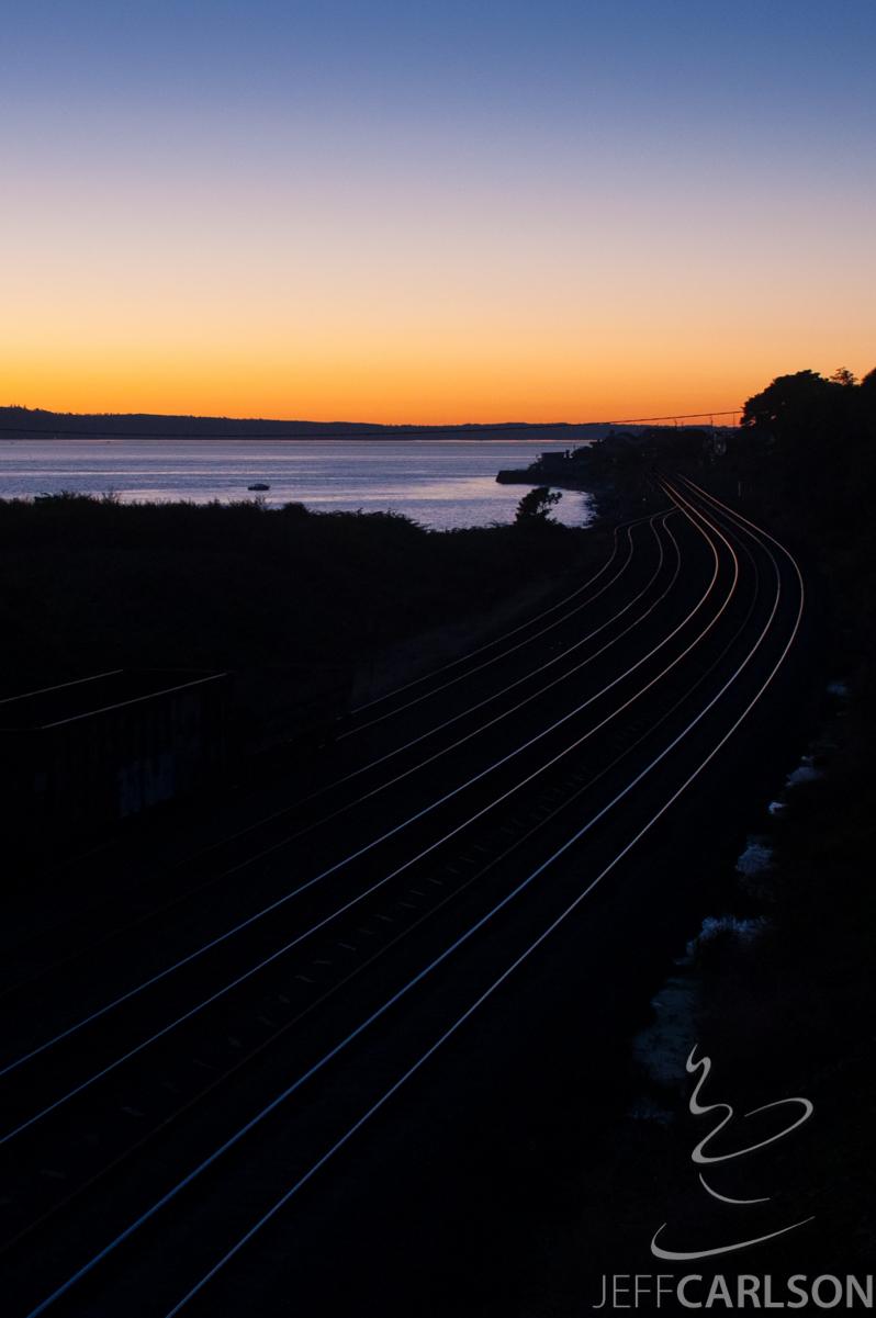 Sunset reflected off railroad tracks, Richmond Beach, WA.