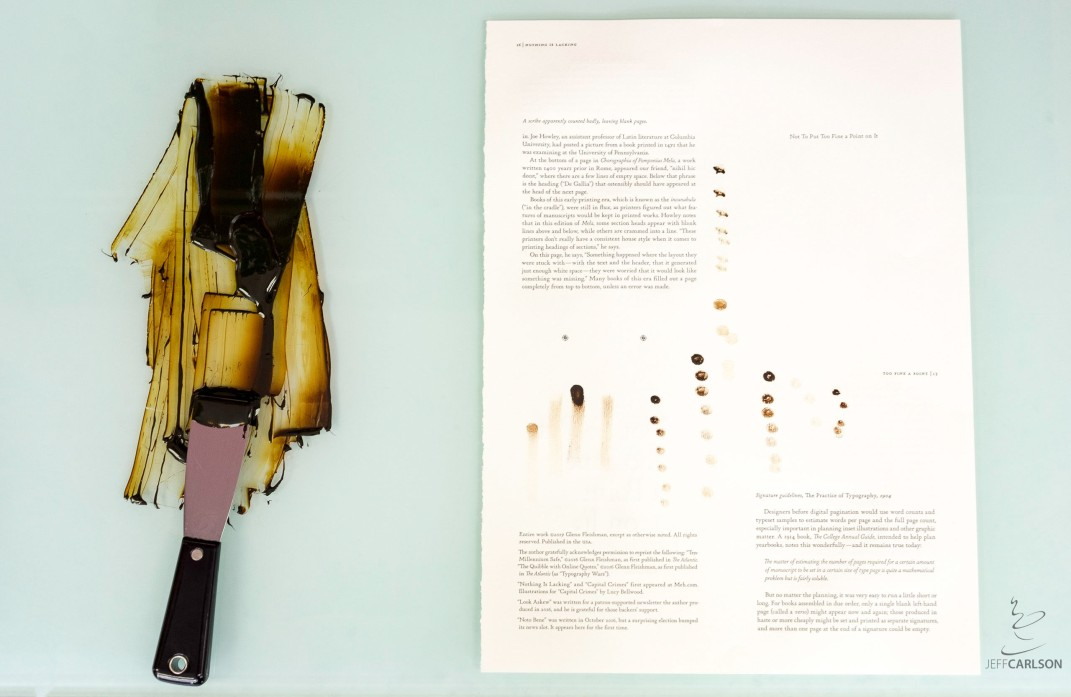 Ink is mixed on a glass table and then dotted onto a sample page from the book to arrive at the right color.